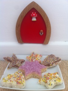 Home made fairy bread waiting for the fairies outside the red fairy door