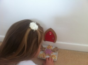 Leaving fairy bread for the fairies outside the red fairy door