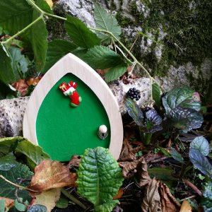 green elf door with log
