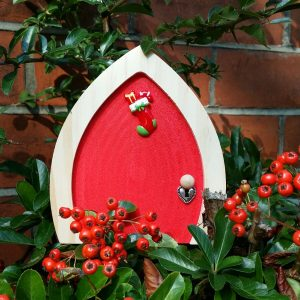 red elf door with berries