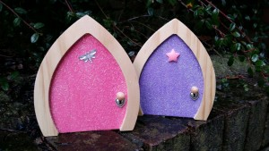 pink and purple sparkle fairy doors